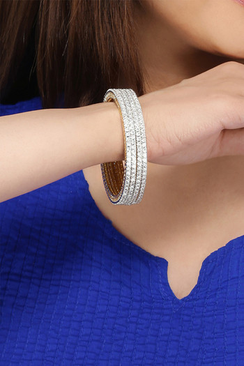 Yellow Chimes Set of 4 PCs White AD Studded Gold Toned Handcrafted Classic Bangles