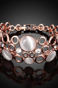 Buy YouBella Stylish Latest Design Party Wear Jewellery Gold Plated Charm Bracelet for Women (Rose Gold) (YBBN_91640)